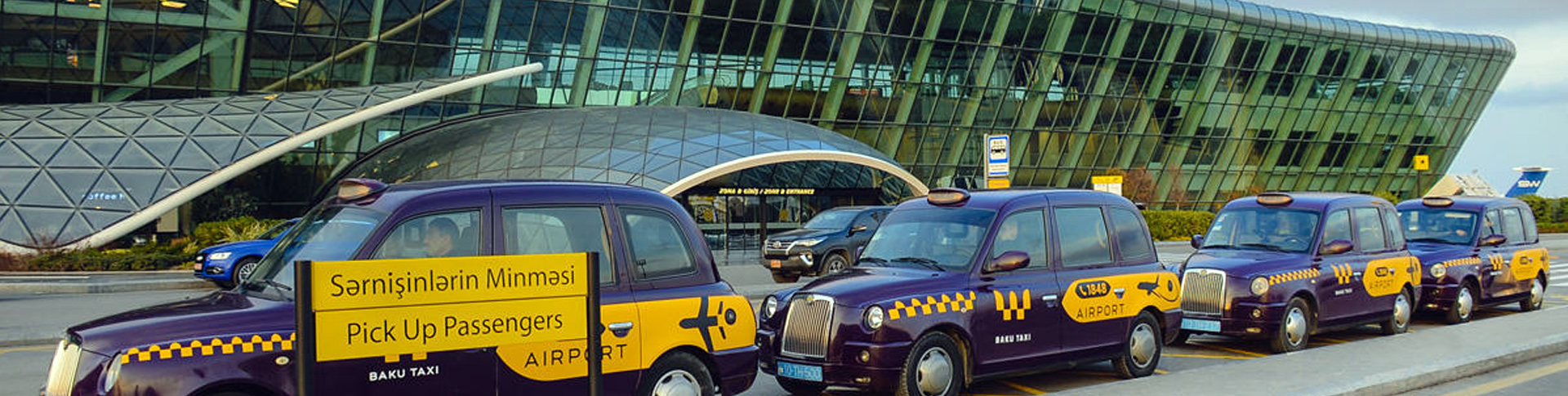 Taxi cabs in from of the Baku airport.